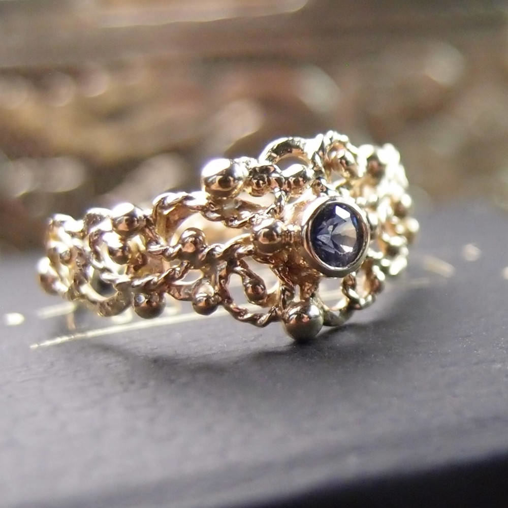 gold ring with blue sapphire by Lookrecya