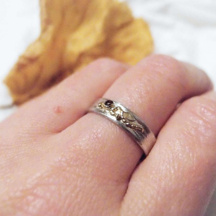 Silver ring with gold botanical motif and natural diamond