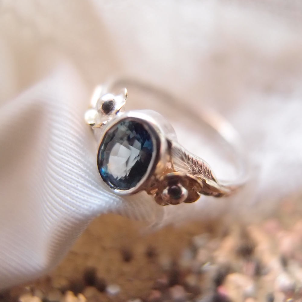 Botanical engagement ring with teal sapphire