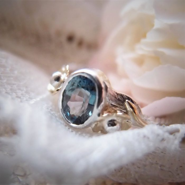 Floral engagement ring with sapphire