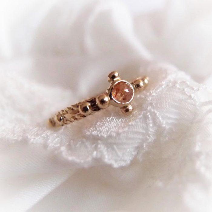 Gold rosary ring with natural diamond