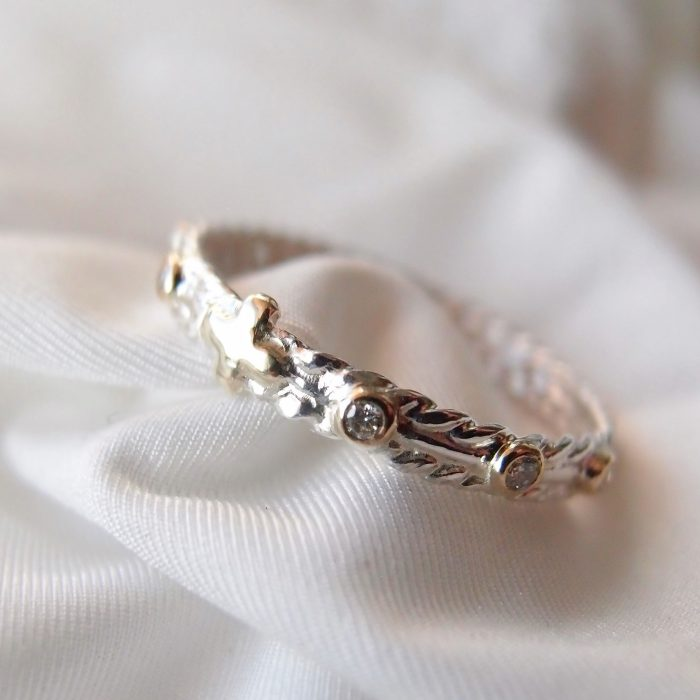 Dainty rosary ring with diamonds