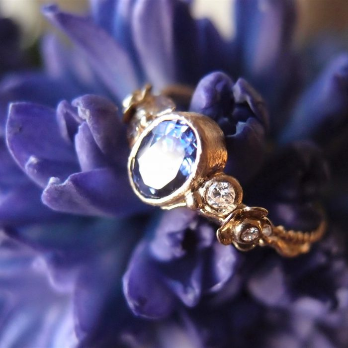 18k gold tanzanite engagementt ring with flower diamonds by Lookrecya