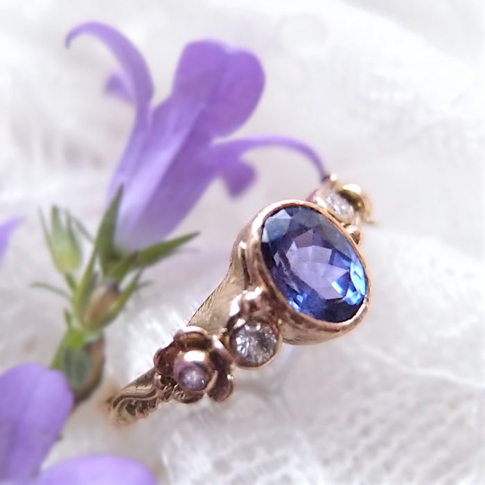 Tanzanite engagement ring with diamond flowers by Lookrecya Dream Jewelry