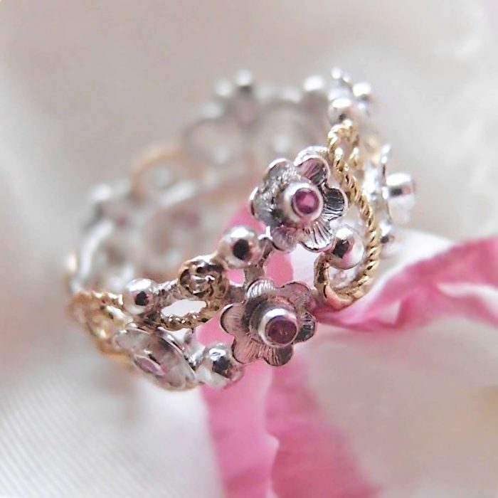 Botanica ring with tiny flowers, rubies and gold details