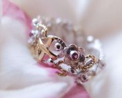 Botanical rosaery ring with ruby flowers and gold details