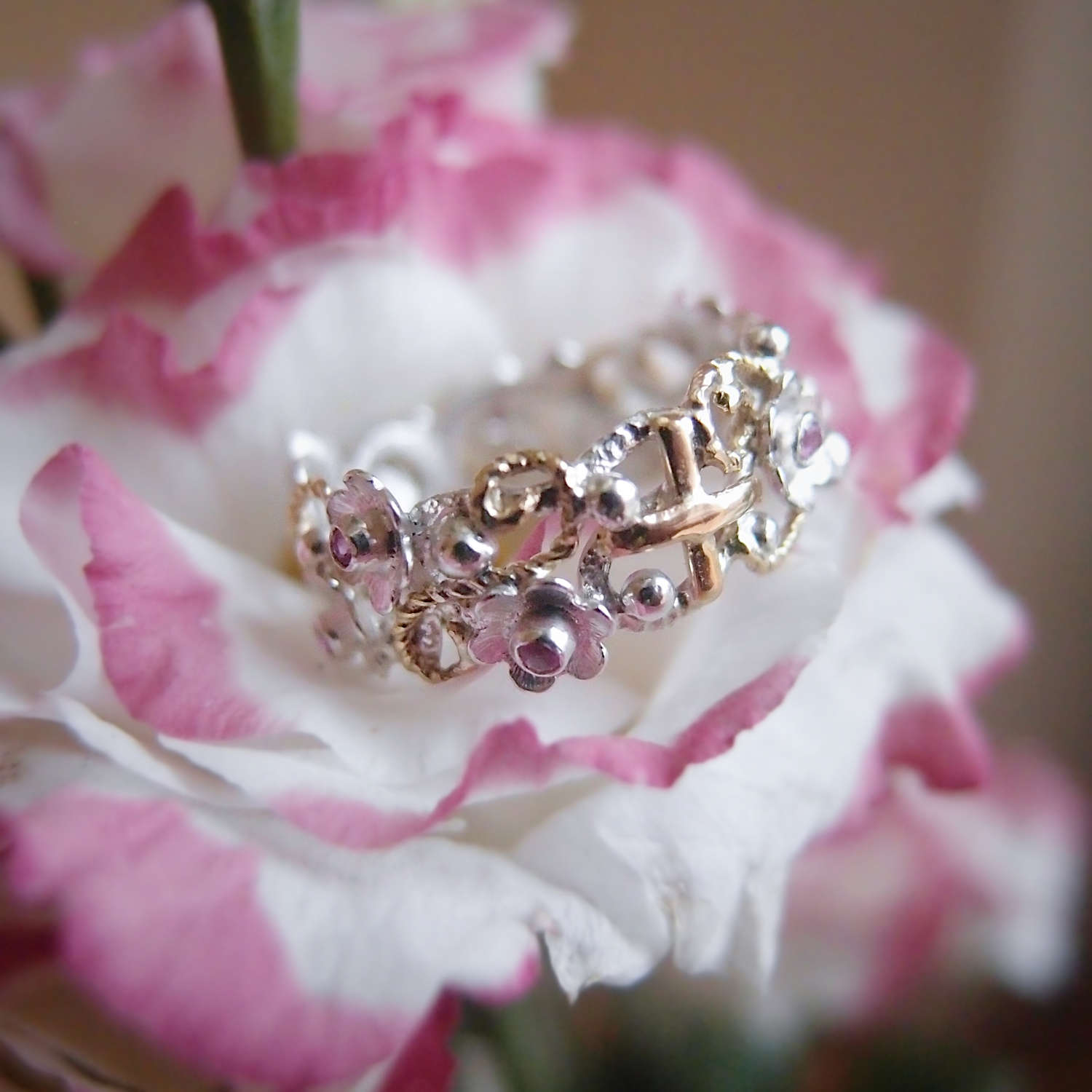 Floral rosary ring with tiny flowers