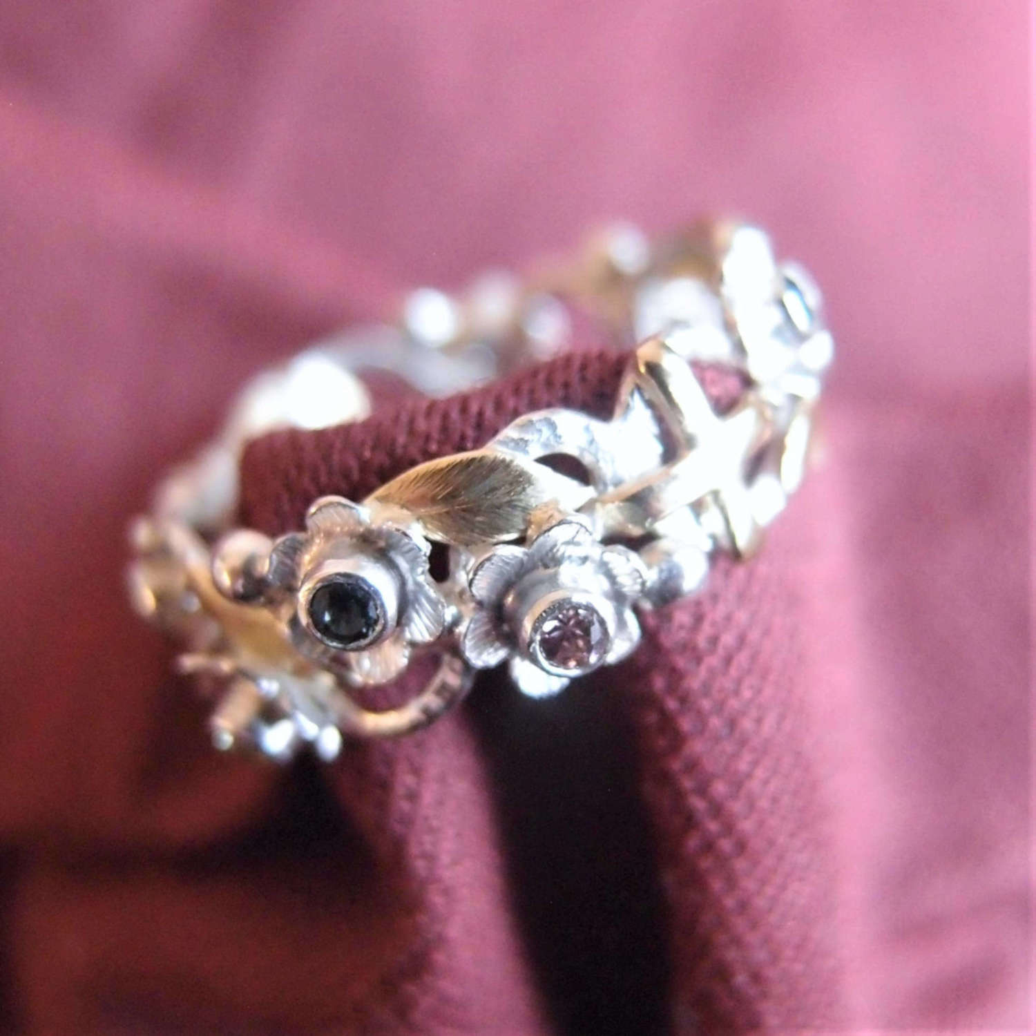 Silver rosary ring with gold leaves and colourful sapphire flowers