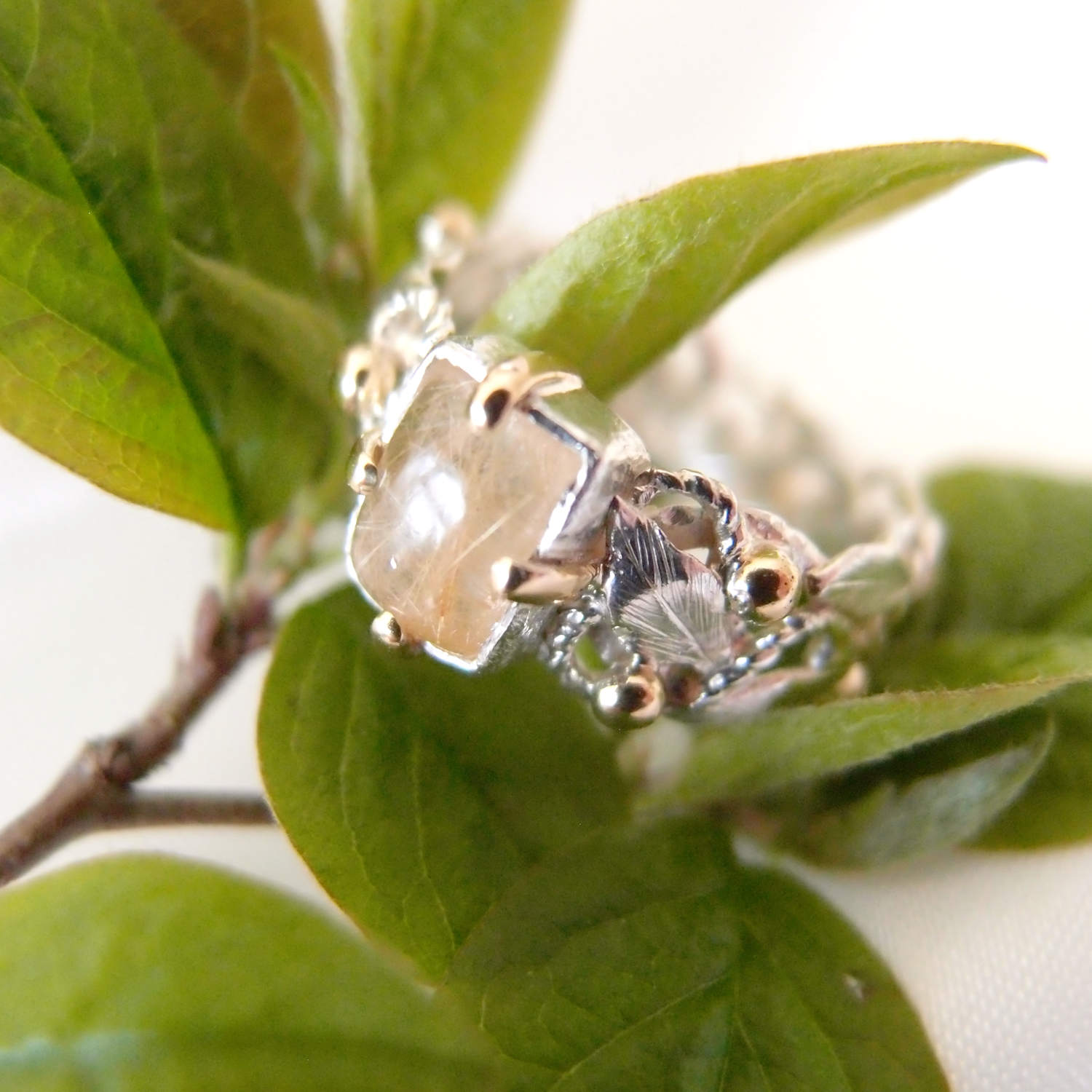 Spring silver ring with silver leaves and gold by Lookrecya