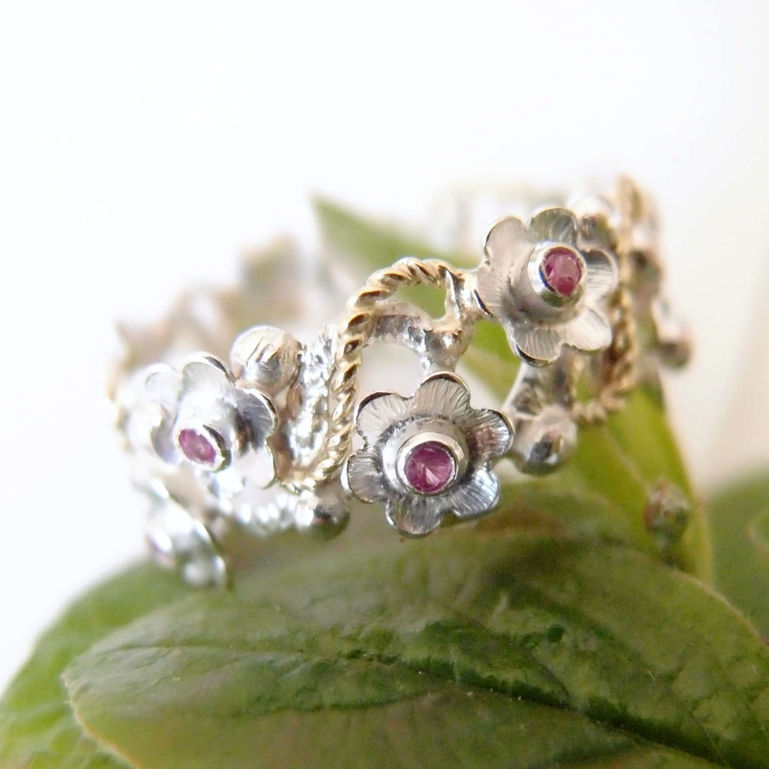 Spring silver ring with gold details and ruby flowers