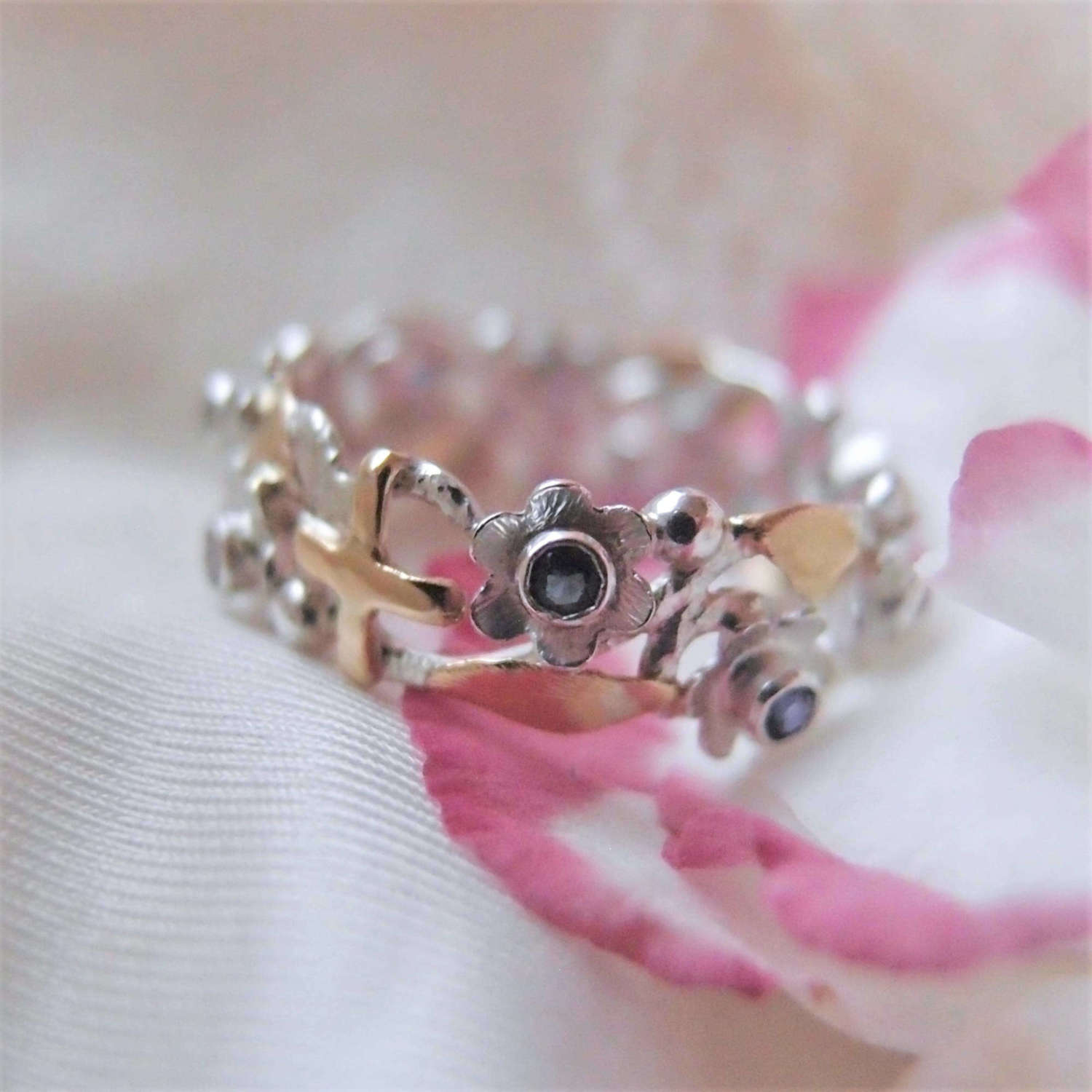 Botanical rosary ring with flowers with