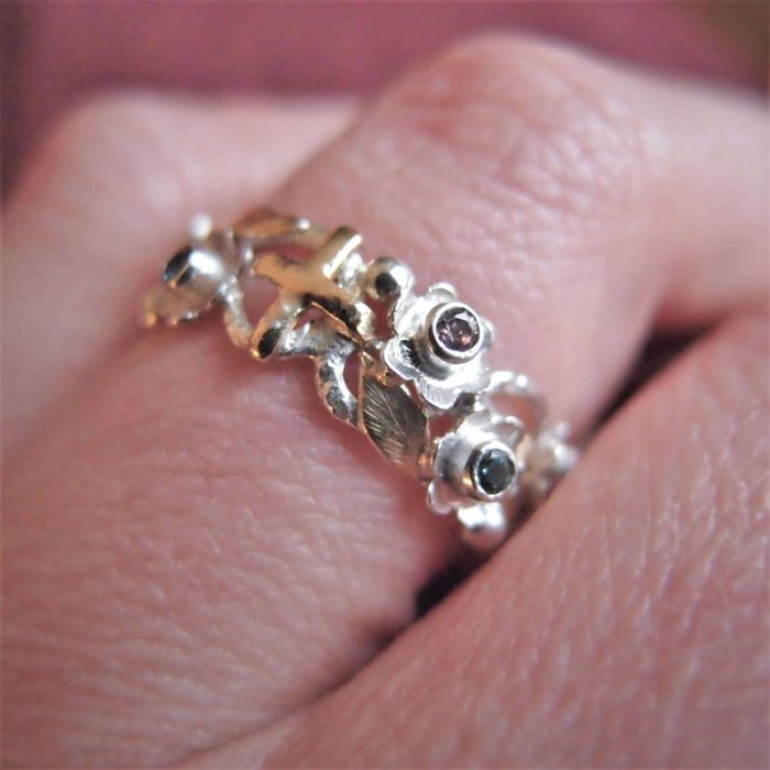 Unique silver rosary ring with flowers