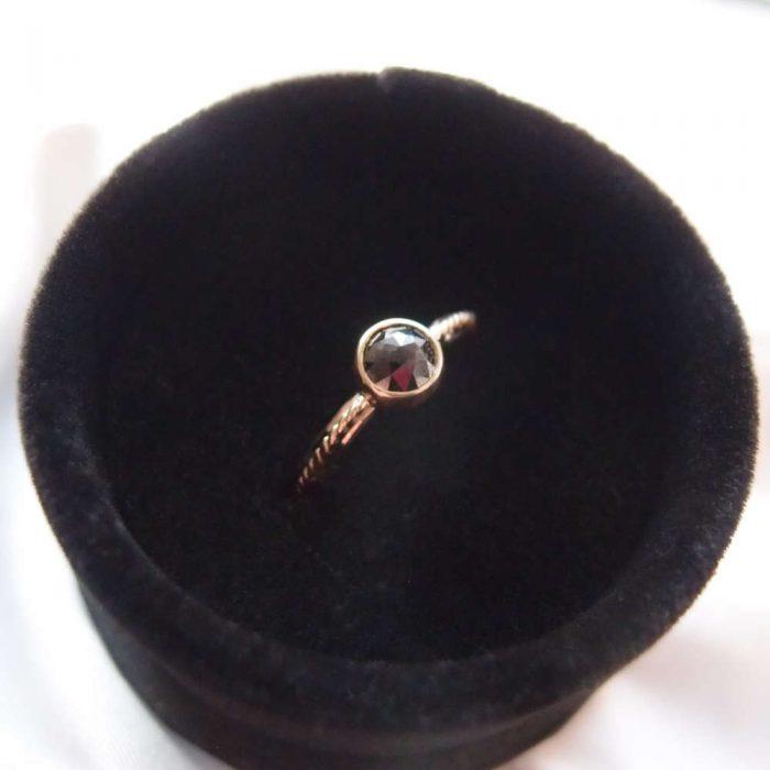 Simple solid black diamond ring
