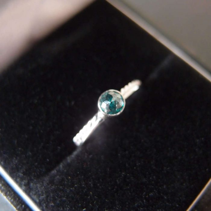 Boho engagement ring with blue diamond