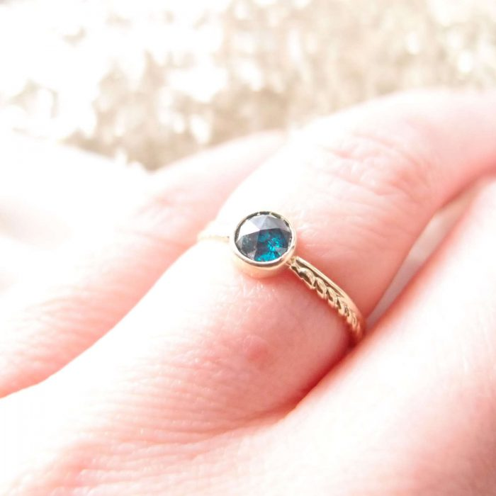 dainty blue diamond ring made of gold