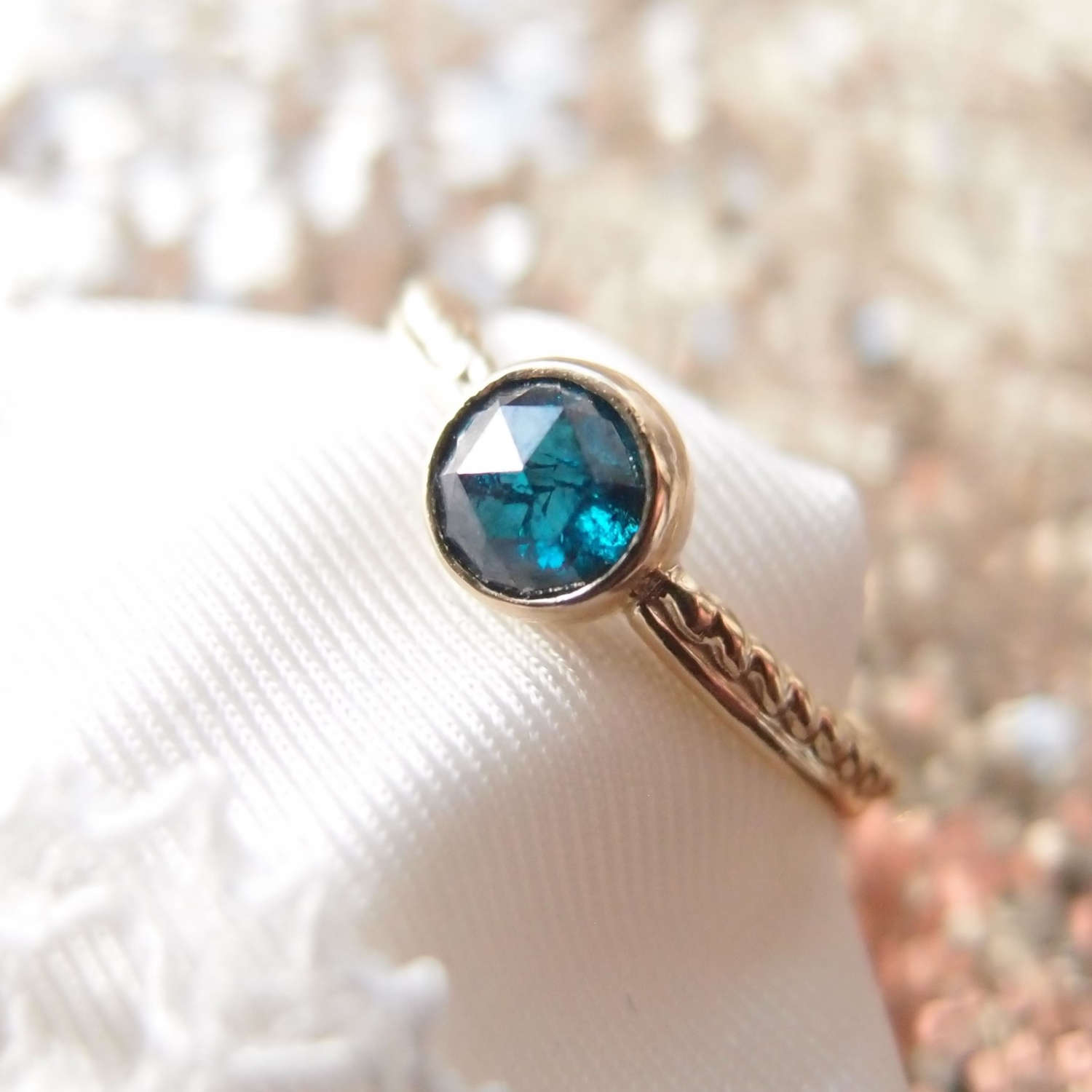 Dainty engagement ring with blue diamond