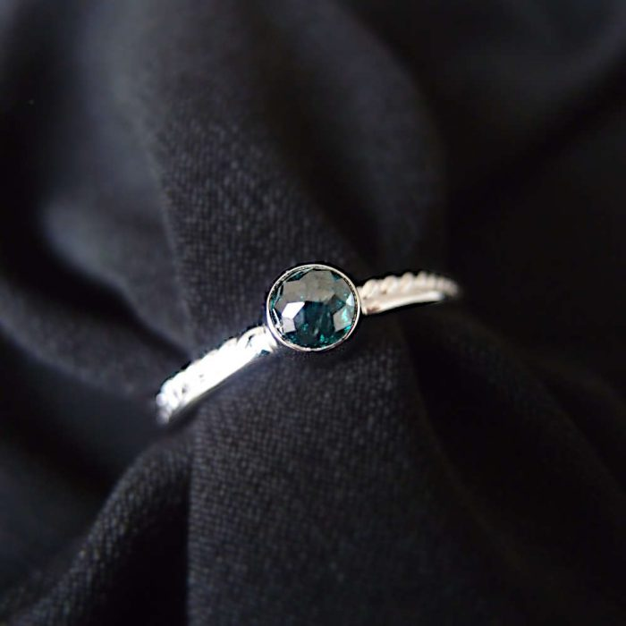 dainty white gold ring with little diamond