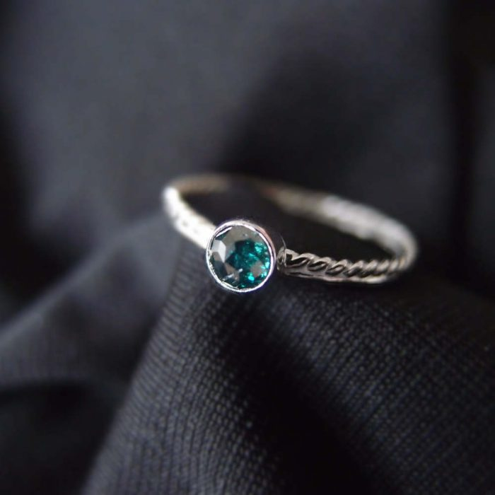 Dainty ring with blue diamond