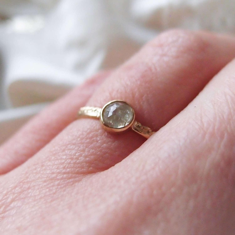 Dainty diamond ring made of 18k gold