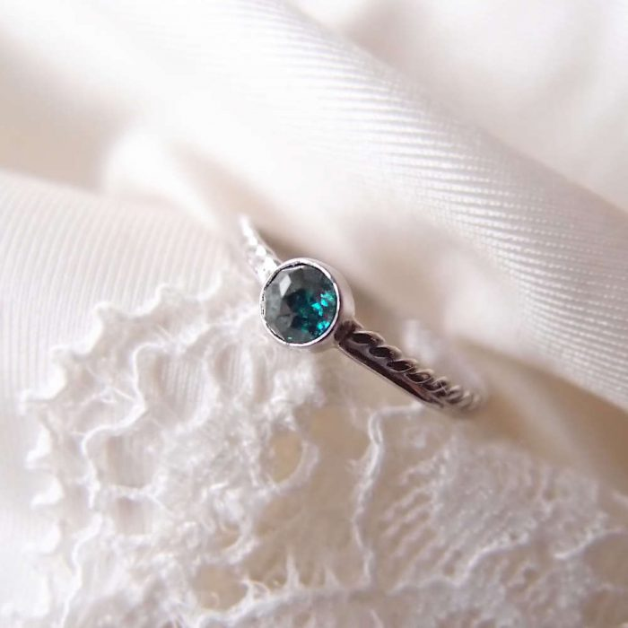 Solid white gold ring with blue diamond